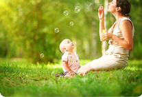 Woman and child blowing bubbles
